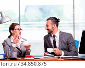 The woman and man in the business concept. Стоковое фото, фотограф Zoonar.com/Elnur Amikishiyev / easy Fotostock / Фотобанк Лори
