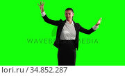 Animation of a mixed race woman in suit in a green background. Стоковое видео, агентство Wavebreak Media / Фотобанк Лори