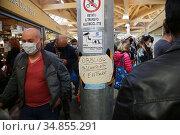 Obligation to wear protective masks at the San Michele Market and... Редакционное фото, фотограф Mirco Toniolo / Errebi / AGF/Mirco Toniolo / Erreb / age Fotostock / Фотобанк Лори