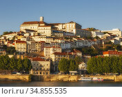 Coimbra, Portugal seen across the Mondego river. Стоковое фото, фотограф UNIVERSAL IMAGES GROUP / age Fotostock / Фотобанк Лори