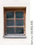 Old dusty window with wooden frame in a white wall. Стоковое фото, фотограф EugeneSergeev / Фотобанк Лори
