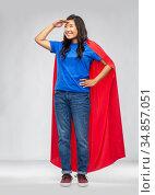 asian woman in superhero cape looking far away. Стоковое фото, фотограф Syda Productions / Фотобанк Лори