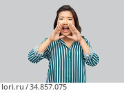 young asian woman calling for someone. Стоковое фото, фотограф Syda Productions / Фотобанк Лори