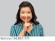 portrait of happy asian woman making hush gesture. Стоковое фото, фотограф Syda Productions / Фотобанк Лори
