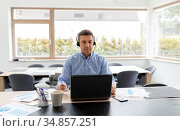 man with headset and laptop working at home. Стоковое фото, фотограф Syda Productions / Фотобанк Лори
