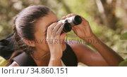 Young woman looking through binoculars. Стоковое видео, агентство Wavebreak Media / Фотобанк Лори
