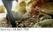 Male hiker standing with backpack near a cave 4k. Стоковое видео, агентство Wavebreak Media / Фотобанк Лори
