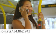 Teenage girl talking on mobile phone in the bus 4k. Стоковое видео, агентство Wavebreak Media / Фотобанк Лори