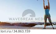 Disabled woman performing yoga in the beach 4k. Стоковое видео, агентство Wavebreak Media / Фотобанк Лори