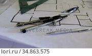 Various tools with blueprint in workshop 4k. Стоковое видео, агентство Wavebreak Media / Фотобанк Лори
