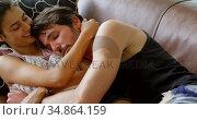 Romantic couple relaxing on sofa in living room 4k. Стоковое видео, агентство Wavebreak Media / Фотобанк Лори