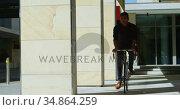 Male commuter riding bicycle on office premises 4k. Стоковое видео, агентство Wavebreak Media / Фотобанк Лори