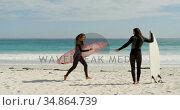Woman with surfboard running towards man 4k. Стоковое видео, агентство Wavebreak Media / Фотобанк Лори