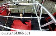 Woman performing monkey bar exercises in fitness gym 4k. Стоковое видео, агентство Wavebreak Media / Фотобанк Лори