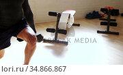 Man exercising with dumbells 4k. Стоковое видео, агентство Wavebreak Media / Фотобанк Лори
