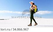 Woman with backpack walking in the desert 4k. Стоковое видео, агентство Wavebreak Media / Фотобанк Лори