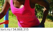 Female athlete exercising with dumbbell in the park 4k. Стоковое видео, агентство Wavebreak Media / Фотобанк Лори