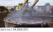 Metal scraps burning in the junkyard 4k. Стоковое видео, агентство Wavebreak Media / Фотобанк Лори