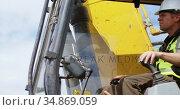 Male worker operating excavator machine 4k. Стоковое видео, агентство Wavebreak Media / Фотобанк Лори