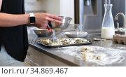 Woman brushing oil on cookie dough in kitchen4k. Стоковое видео, агентство Wavebreak Media / Фотобанк Лори