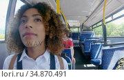 Young girl travelling on a bus 4k. Стоковое видео, агентство Wavebreak Media / Фотобанк Лори