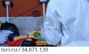 Physician checking senior man donating blood 4k. Стоковое видео, агентство Wavebreak Media / Фотобанк Лори