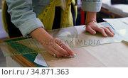 Fashion designer marking on brown paper at desk 4k. Стоковое видео, агентство Wavebreak Media / Фотобанк Лори