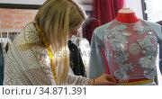 Fashion designer measuring dress on dressmakers model 4k. Стоковое видео, агентство Wavebreak Media / Фотобанк Лори