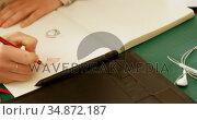Female jewelry designer drawing sketch on white paper 4k. Стоковое видео, агентство Wavebreak Media / Фотобанк Лори