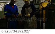 Metalsmiths lighting welding torch in workshop 4k. Стоковое видео, агентство Wavebreak Media / Фотобанк Лори