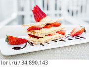 Strawberry Mille Feuille cake in white plate. Стоковое фото, фотограф Vichaya Kiatying-Angsulee / easy Fotostock / Фотобанк Лори