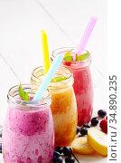 Assorted fruit shakes on white table. Smoothie concept. Стоковое фото, фотограф Olena Mykhaylova / easy Fotostock / Фотобанк Лори