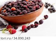 Ceramic bowl with organic blackberries on white table. Стоковое фото, фотограф Olena Mykhaylova / easy Fotostock / Фотобанк Лори