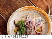 Herring fillets served with olives onions and dill on wooden table. Стоковое фото, фотограф Olena Mykhaylova / easy Fotostock / Фотобанк Лори