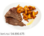 Homemade baked beef fillet with potato wedges. Стоковое фото, фотограф Яков Филимонов / Фотобанк Лори