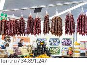 Oriental sweets, Georgian national food dessert, churchkhela with juice, sugar and nuts hanging on a display in a bazaar on sale. Стоковое фото, фотограф Светлана Евграфова / Фотобанк Лори