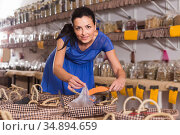 female customer taking cereals with scoop from basket in eco market. Стоковое фото, фотограф Яков Филимонов / Фотобанк Лори