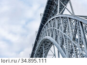 A fragment of Maria Pia Bridge over the river Duoro in Porto, Portugal, built in 1877 and attributed to Gustave Eiffel (2018 год). Стоковое фото, фотограф Сергей Фролов / Фотобанк Лори