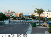 Empty streets of the Protaras town at morning time. The Protaras is a predominantly tourist resort in Paralimni municipality. Protaras, Cyprus (2010 год). Редакционное фото, фотограф Кекяляйнен Андрей / Фотобанк Лори
