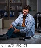 Man fell off wheelchair sitting on the floor. Стоковое фото, фотограф Elnur / Фотобанк Лори