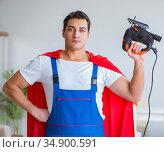 Super hero repairman working at home. Стоковое фото, фотограф Elnur / Фотобанк Лори
