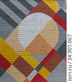 Brick wall with an abstract geometric pattern. Стоковое фото, фотограф Юрий Бизгаймер / Фотобанк Лори