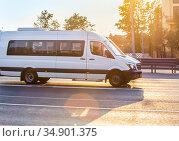 Minibus goes on the city street. Стоковое фото, фотограф Юрий Бизгаймер / Фотобанк Лори