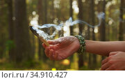 woman or witch performing magic ritual in forest. Стоковое видео, видеограф Syda Productions / Фотобанк Лори