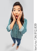 shocked asian woman with open mouth goggling. Стоковое фото, фотограф Syda Productions / Фотобанк Лори