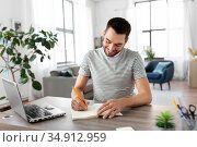 man with notebook and laptop at home office. Стоковое фото, фотограф Syda Productions / Фотобанк Лори