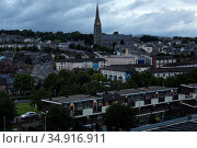 Great Britain, Derry - Bogside, a catholic district that plays a special role in the Northern Ireland conflict, in the picture St Eugene's Cathedral (2019 год). Редакционное фото, агентство Caro Photoagency / Фотобанк Лори