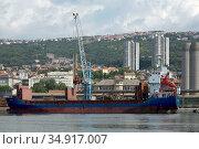 Croatia, Rijeka - Metal scrap is loaded on a freighter. Редакционное фото, агентство Caro Photoagency / Фотобанк Лори