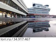 Berlin, Germany, Terminal of Berlin-Tegel Airport reflected in a puddle. Редакционное фото, агентство Caro Photoagency / Фотобанк Лори