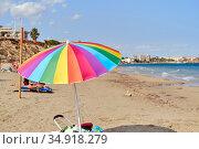 Multi colored parasol on the beach of Mil Palmeras, Spain. Стоковое фото, фотограф Alexander Tihonovs / Фотобанк Лори